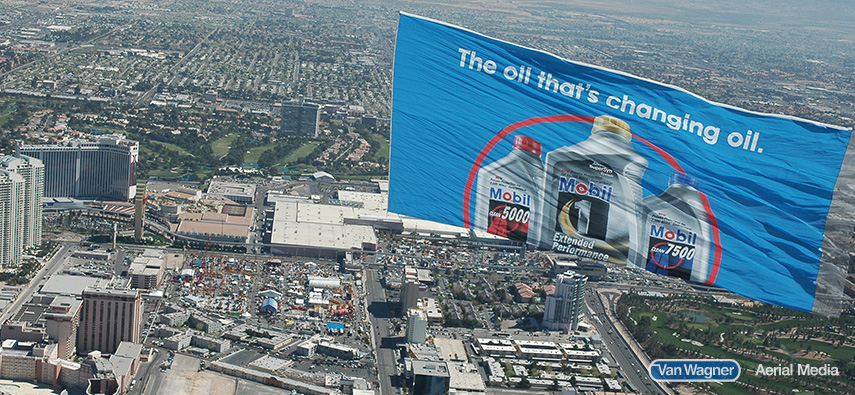 Mobil Oil helicopter banner flies through the sky.
