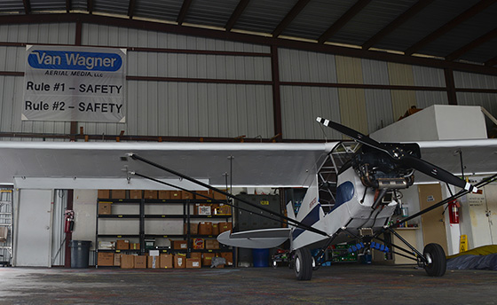 The inside of a Van Wagner hangar with a fixed wing plane.